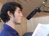 Chak recording voiceover in a quiet garden shed.